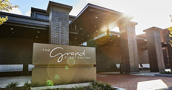 the grand event center entrance and sign